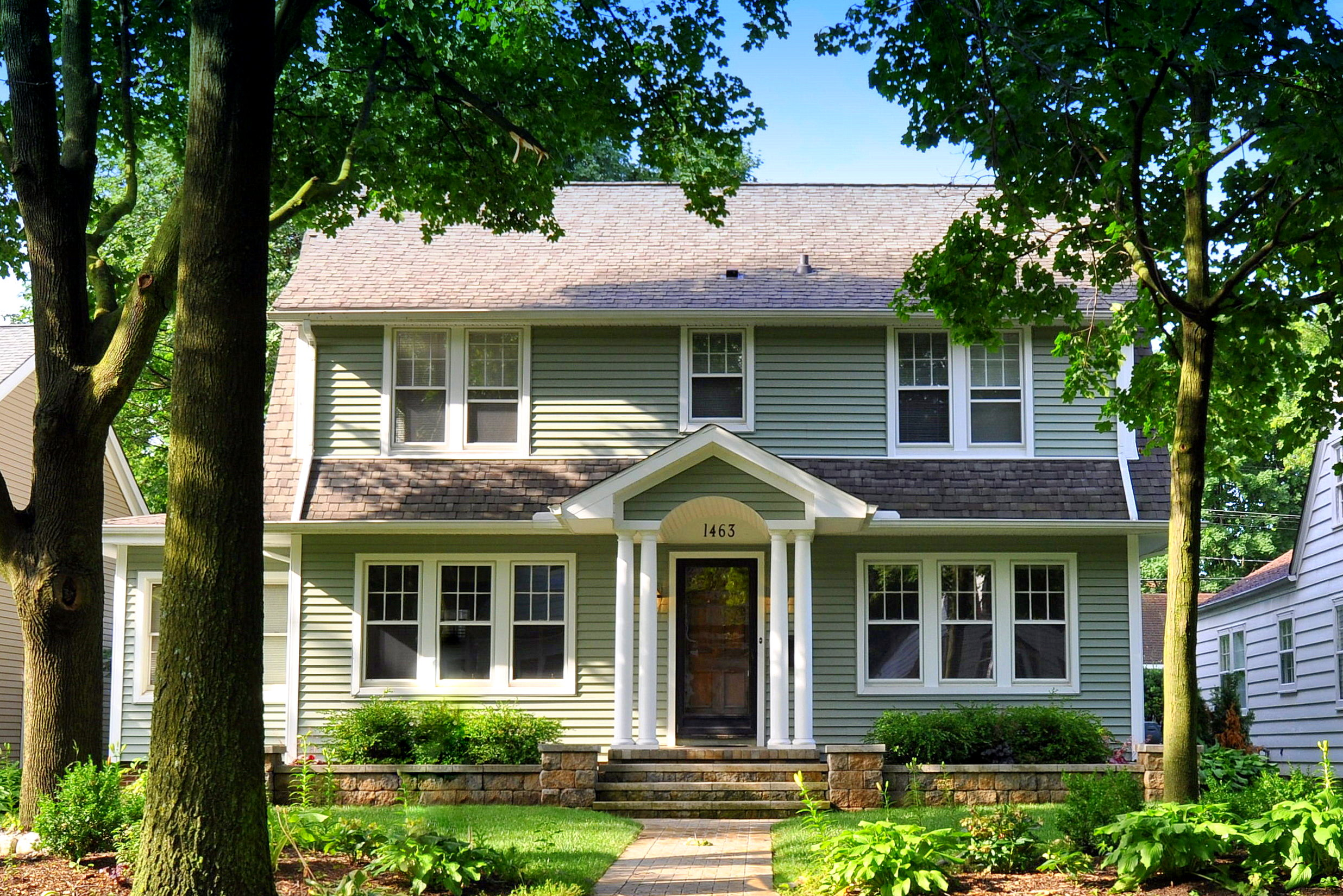 This home just sold 1463 sheridan city of plymouth updated and expanded dutch colonial on a for Updated colonial home exterior